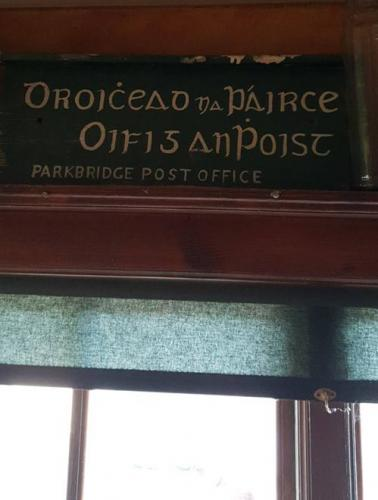"The original Parkbridge Post Office sign ""Oifig an Phoist"". Egans originally ran the post office, and later the next door neighbours Byrnes ran it until the early 2000s."