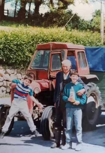 Patrick Egan, Tommy Spratt, Lawrence Egan in front of Tommy's old Massey Ferguson tractor
